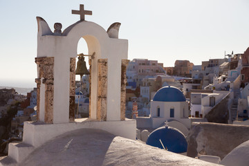 View of Oia Village with windmills at sunset Santorini, Greece
