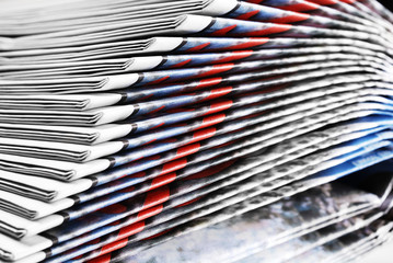 Close-up of Heap of Folded Newspapers, Selective Focus