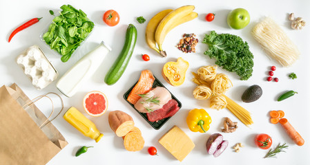 Grocery shopping concept - meat, fish, fruits and vegetables with shopping bag, top view