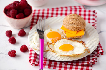 Breakfast  fried Eggs with buns and cheese