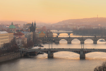Golden sunset view of Prague from Letna park with bridges over Vltava river and Charles bridge. Prague. Czech Republic.