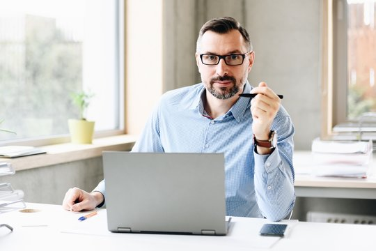 middle aged handsome man working on laptop computer