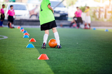 Soccer player jump and stomp for training to trap and control football