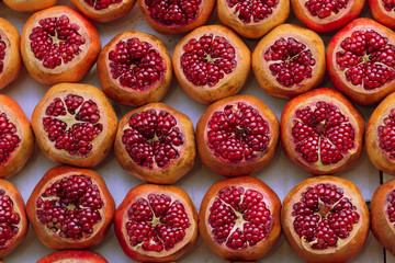 cut pomegranate in the market
