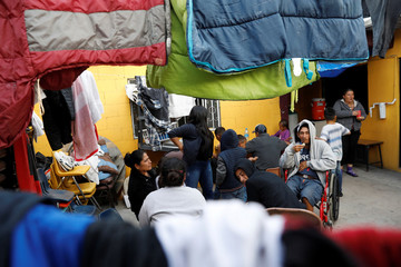 Migrant families, part of a caravan of thousands from Central America tying to reach the United States, sit at Iglesia Cristiana Bautista Camino Salvation shelter in  Tijuana, Mexico