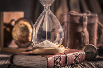 Hourglass and journal as a concept of journey diary