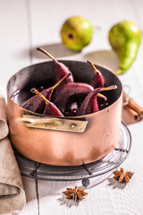 Tasty mulled wine with pears on white table