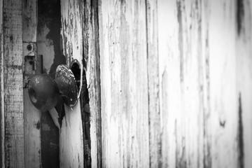 Broken lock on an old open wooden door