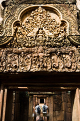 Tourists visit Banteay Srei temple to view the detailed carvings of Buddha, elephants, demons and ornamental patterns.