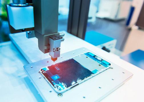 robotic machine measure the aluminum mobile phone part .