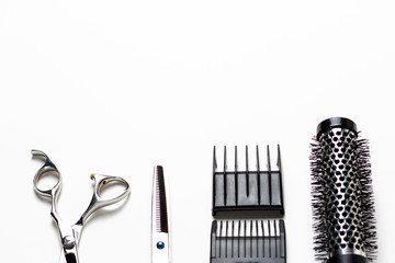 Scissors and comb on a white background, copy space