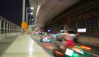 Spoed Fotobehang Aziatische Plekken Go-karts on public road in Tokyo 公道を走るゴーカート(東京レインボーブリッジ)