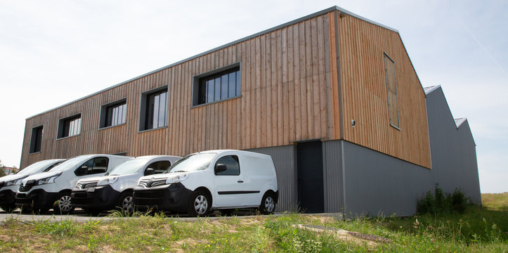 Loading delivery vans in front of cargo doors warehouse for delivery