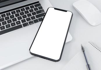 Modern smartphone mockup laying on laptop 3d rendering