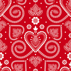 Folklore floral Nordic Scandinavian pattern vector seamless. Ethnic ornament with hearts and flowers on red background. Design for holiday fabric, gift wrapping paper, party invitation backdrop.