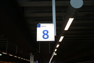 Sign leading to the platforms of train or metro on den Haag centraal station in the Netherlands