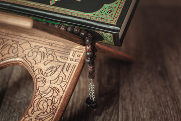 The holy book of the Koran on the stand
