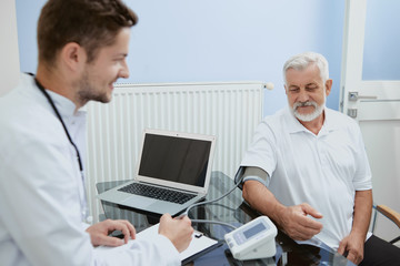 Doctor and elderly man during consultation.