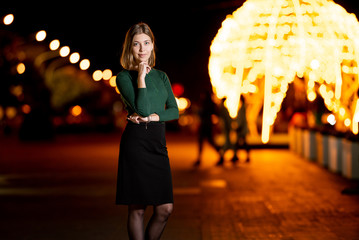 Young beautiful woman in evening night city