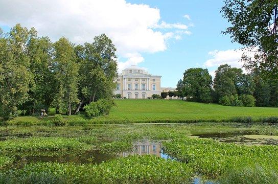 Palace and facade pond in August. Pavlovsky Park. The city of Pavlovsk.