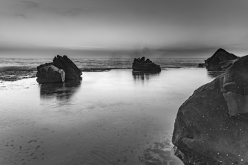 Sunrise Seascape and Rock Ledge in Black and White