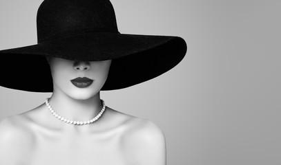 Retro woman beautiful model wearing classic hat and pearls, fashion portrait