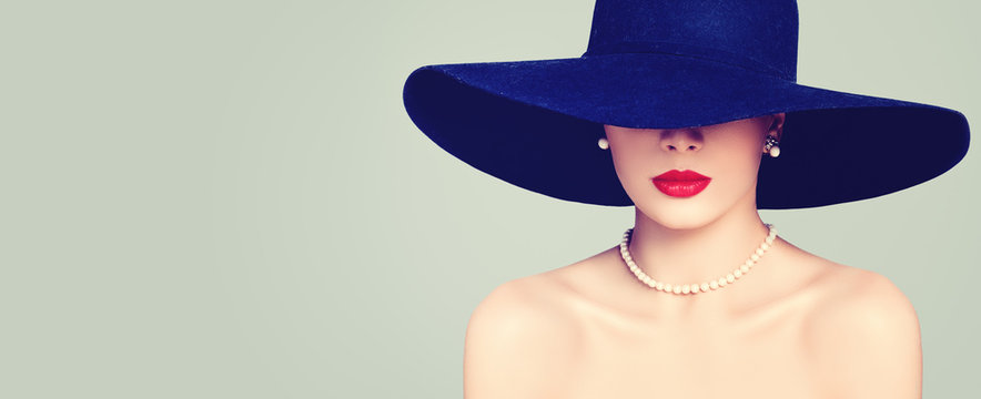 Fashion portrait of stylish woman with red lips makeup, elegant hat and pearls