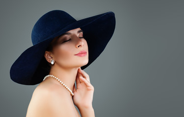 Perfect model woman in classic hat and white pearls, fashion portrait