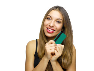 Portrait of a lovely young woman showing credit card and looking at camera isolated over white background