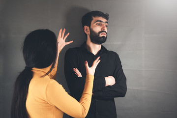 angry woman and man on dark background