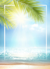 Photo sur Plexiglas Plage Summer background with frame, nature of tropical golden beach with rays of sun light and leaf palm. Golden sand beach close-up, sea water, blue sky, white clouds. Copy space, summer vacation concept.