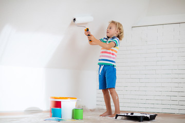 Kids painting attic wall. Home improvement.