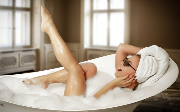 Luxury interior and slim young woman in white bath.