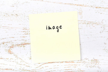 Yellow sticky note with handwritten text image