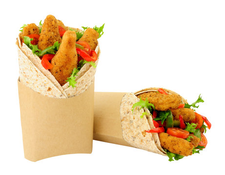 Southern fried chicken fillets and salad in wholemeal tortilla wraps isolated on a white background