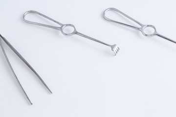 Concept for medicine. Vintage surgical instruments on white isolated background.