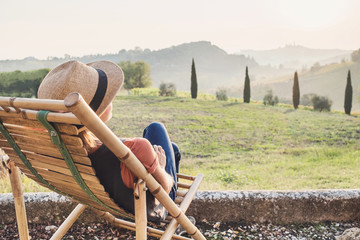 Fond de hotte en verre imprimé Toscane Enjoying life. Young woman looking at the valley in Italy, relaxation, vacations, lifestyle, summer fun concept. Vacations in Italy
