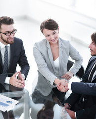 handshake business partners for their Desk