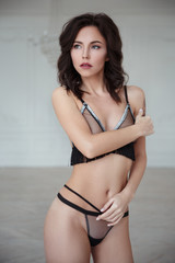 a5dfdc68f27 Beautiful sexy girl in lingerie sits in an elegant armchair. - Buy ...
