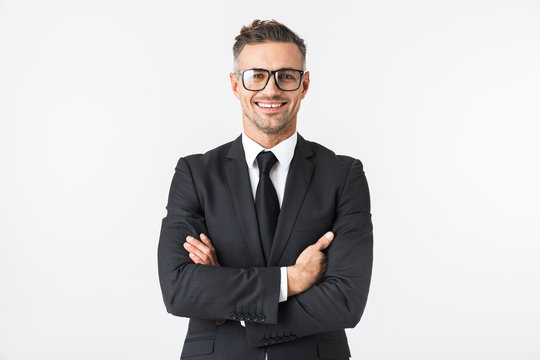 Handsome business man isolated over white wall background posing.