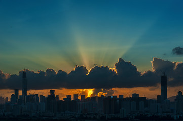 Fototapete - Silhouette of Skyline of Shenzhen City, China at sunset. Viewed from Hong Kong border