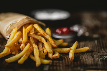 Fototapeta French fries in a basket with ketchup obraz