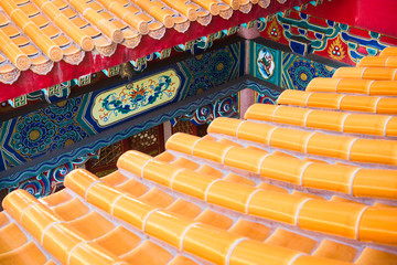Roof detail of Chinese Temple texture background. Beautiful Chinese temple roof detail with colorful architectural work at Wat Leng Nei Yi 2, Nonthaburi, Thailand
