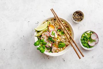 Bowls with Asian soup Ramen