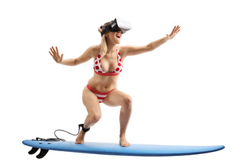 Young woman in bikini surfing with a VR set