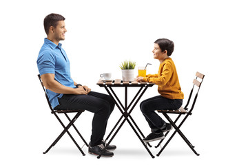 Father and son at a coffee table