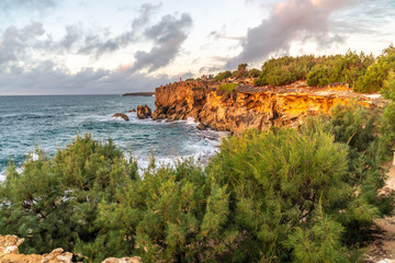 Visitors gathered on the cliff to watch the sunrise over the ocean, Poipu, Koloa, Kauai, Hawaii