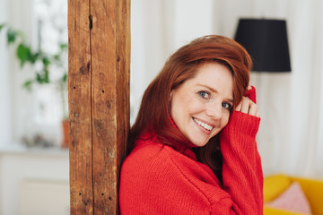 Pretty young redhead woman in red polo neck
