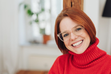 Pretty young redhead woman in glasses