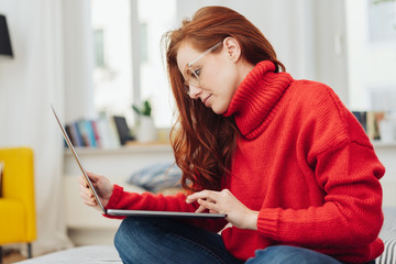 Young woman in a bright red winter sweater